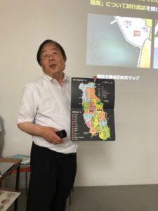 写真:防災マップを説明する山崎氏