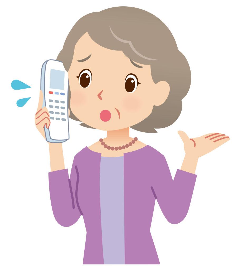イラスト:電話で相談する高齢女性