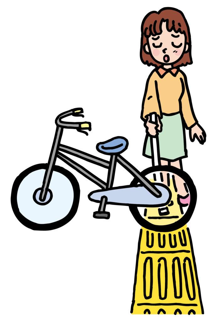 イラスト:点字ブロックを歩く女性の前に自転車が置かれている